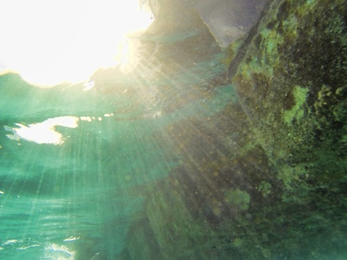 sun on the underwater rocks of St Maarten